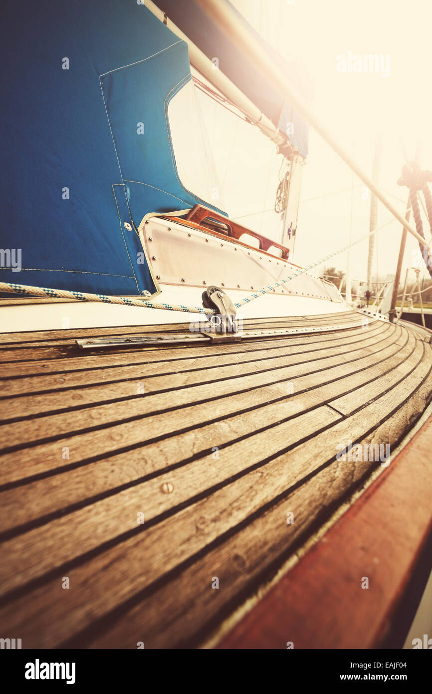 Vintage filtered close up picture of yacht deck and rigging. - Stock Image