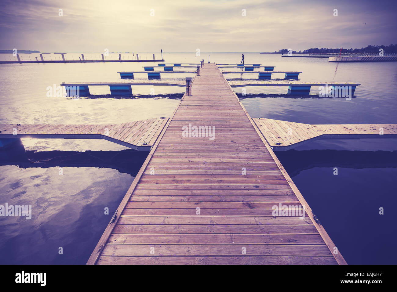 Filtered Vintage Retro Styled picture of marina at sunset. - Stock Image
