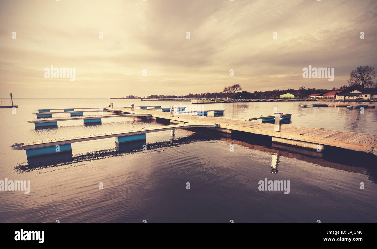 Filtered Retro Styled picture of marina at sunset. - Stock Image