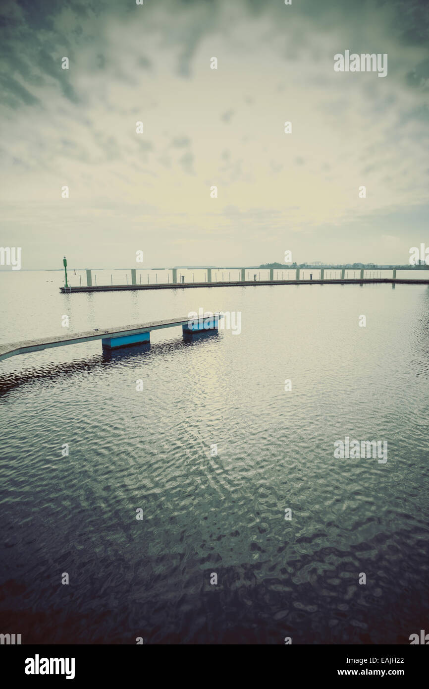 Retro filtered picture of lake at sunset. - Stock Image