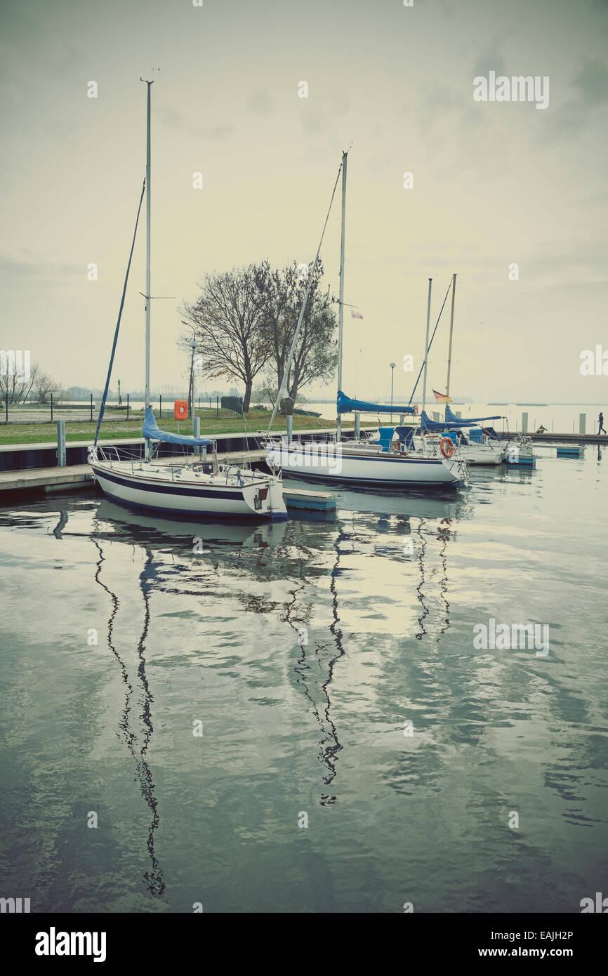 Marina with yachts at sunset, retro vintage effect. - Stock Image