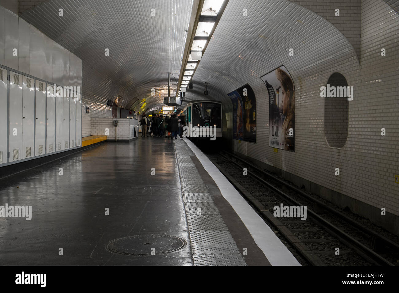 Paris Metro train arriving at a station, Paris France - Stock Image