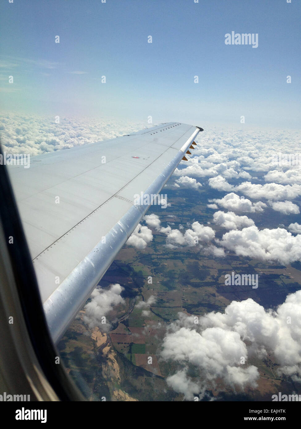 Airplane wing and clouds. - Stock Image