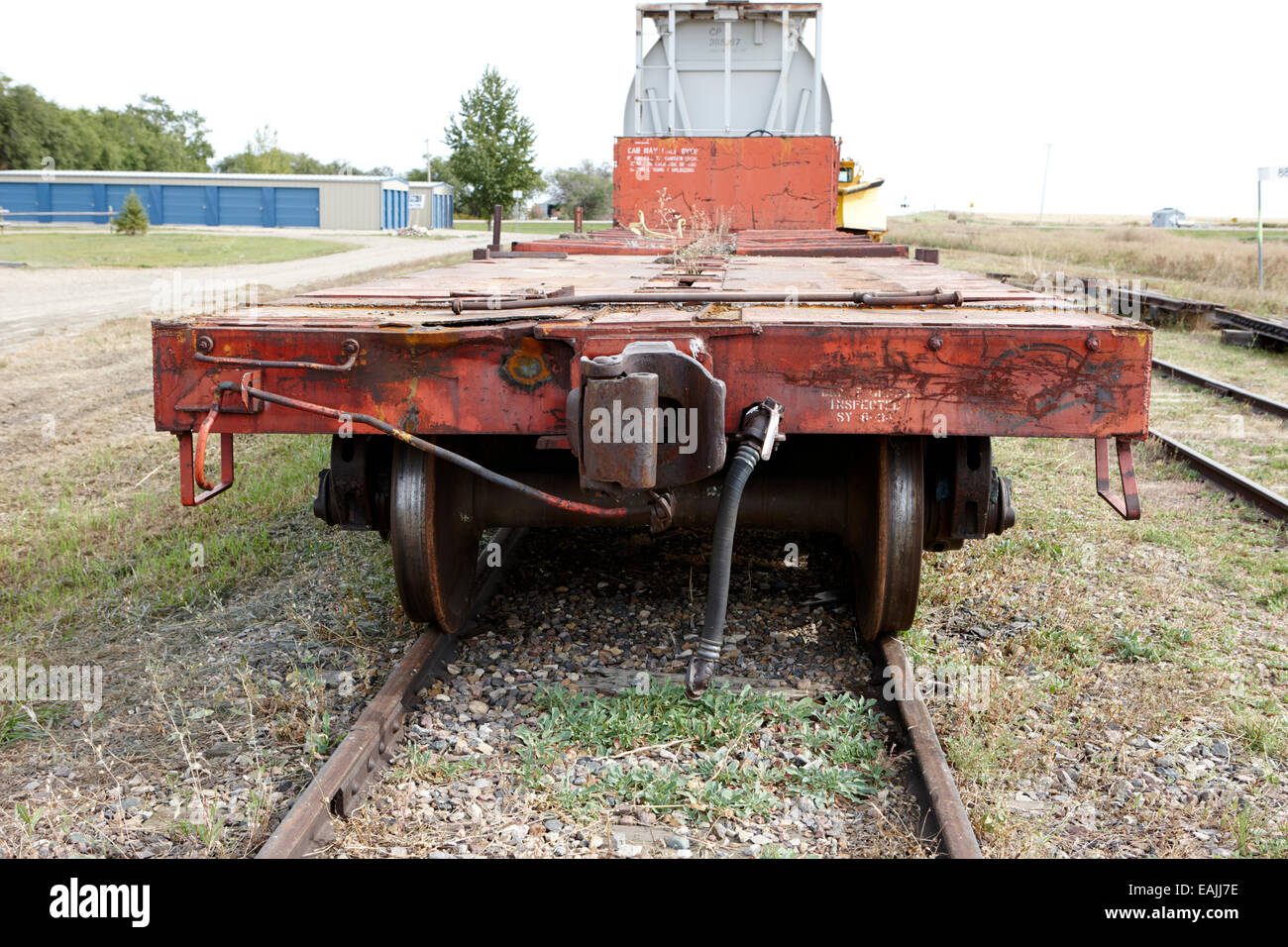 empty flat cargo railroad car Saskatchewan Canada - Stock Image