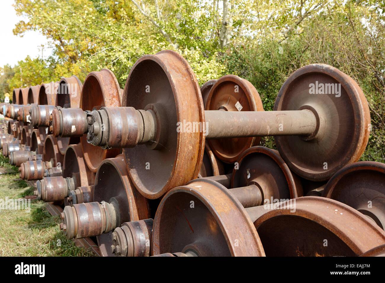 pile of spare train wheels Saskatchewan Canada - Stock Image