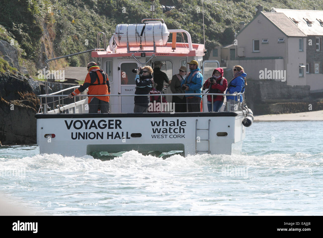 Nic Slocum's vessel 'Voyager' on a whale watching and sight seeing trip entering the harbour at Cape - Stock Image