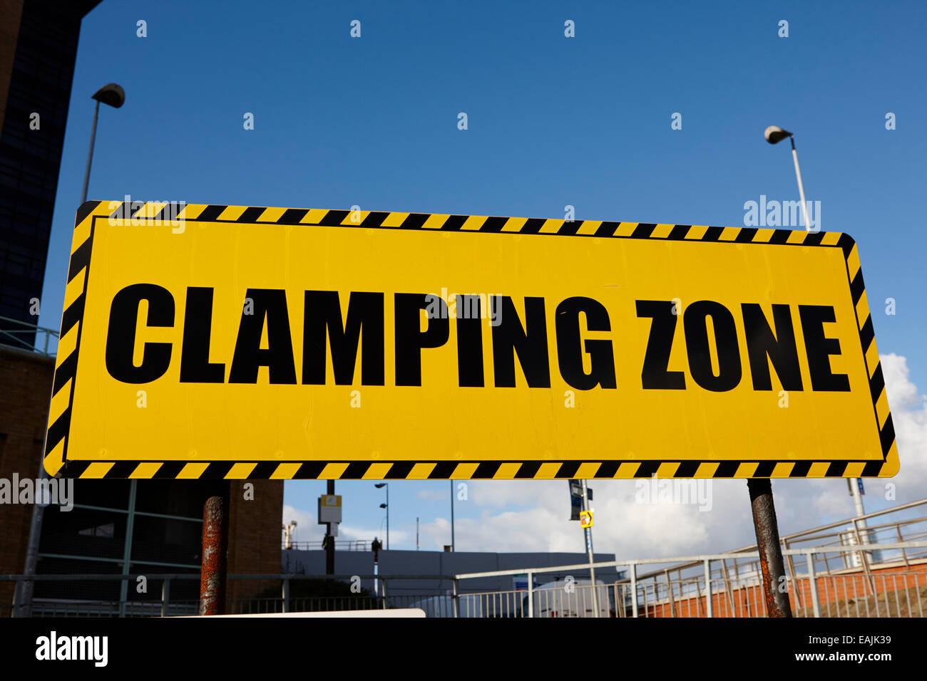 clamping zone signpost Belfast Northern Ireland - Stock Image