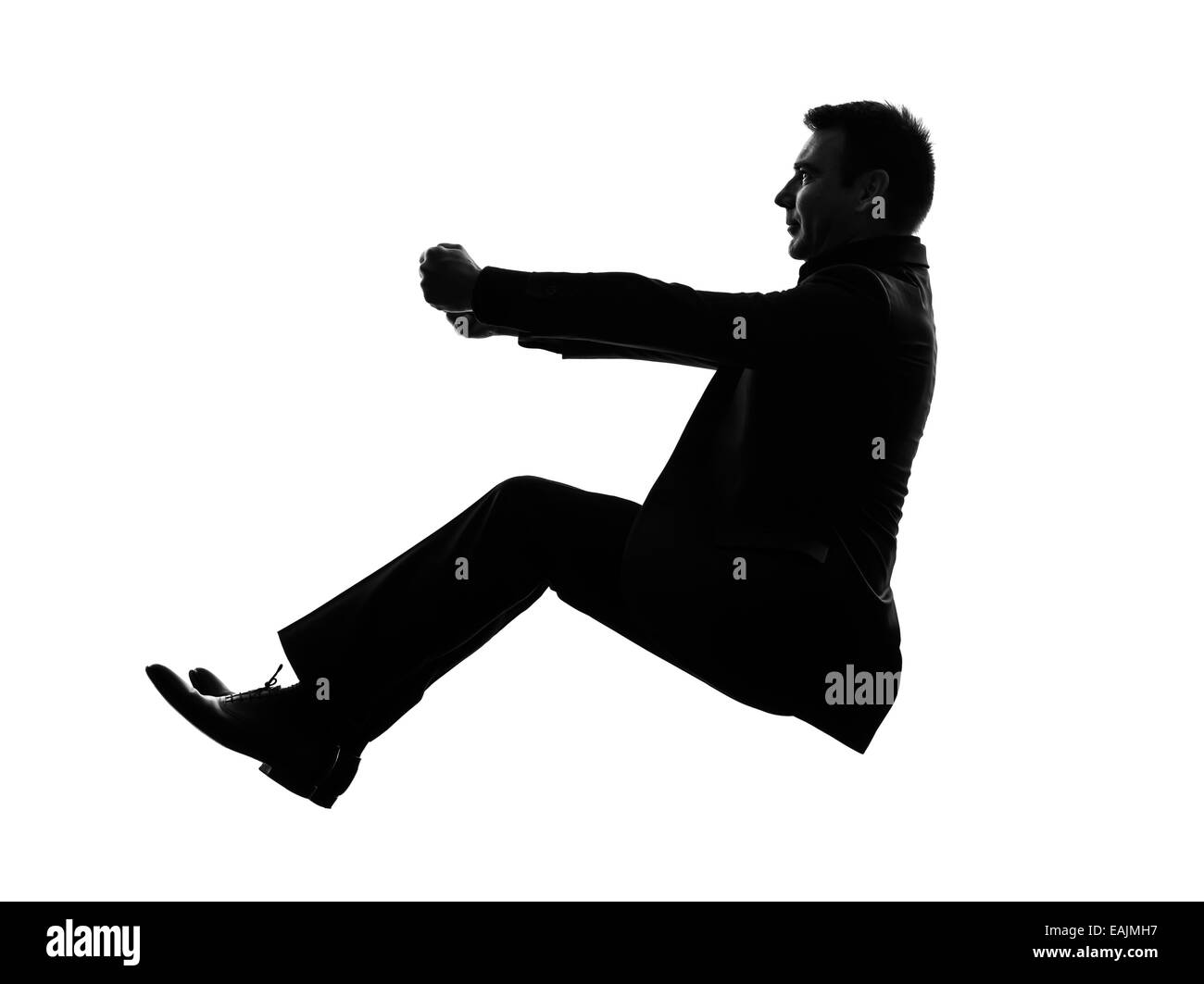 one caucasian business man driving in silhouette on white background - Stock Image