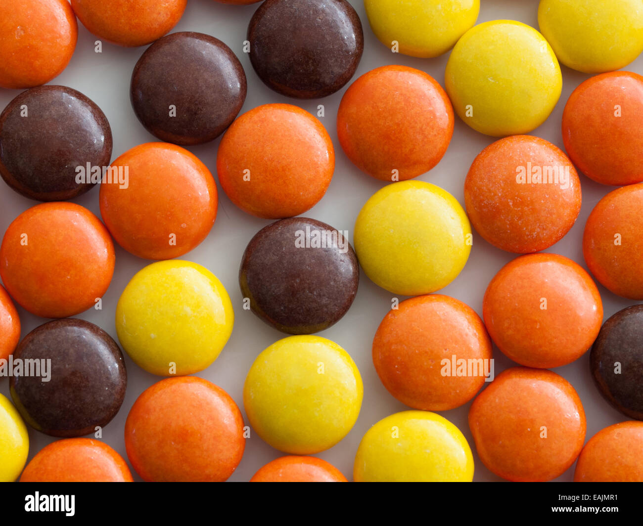 A close-up of Reese's Pieces peanut butter candy. Manufactured by The Hershey Company. Stock Photo