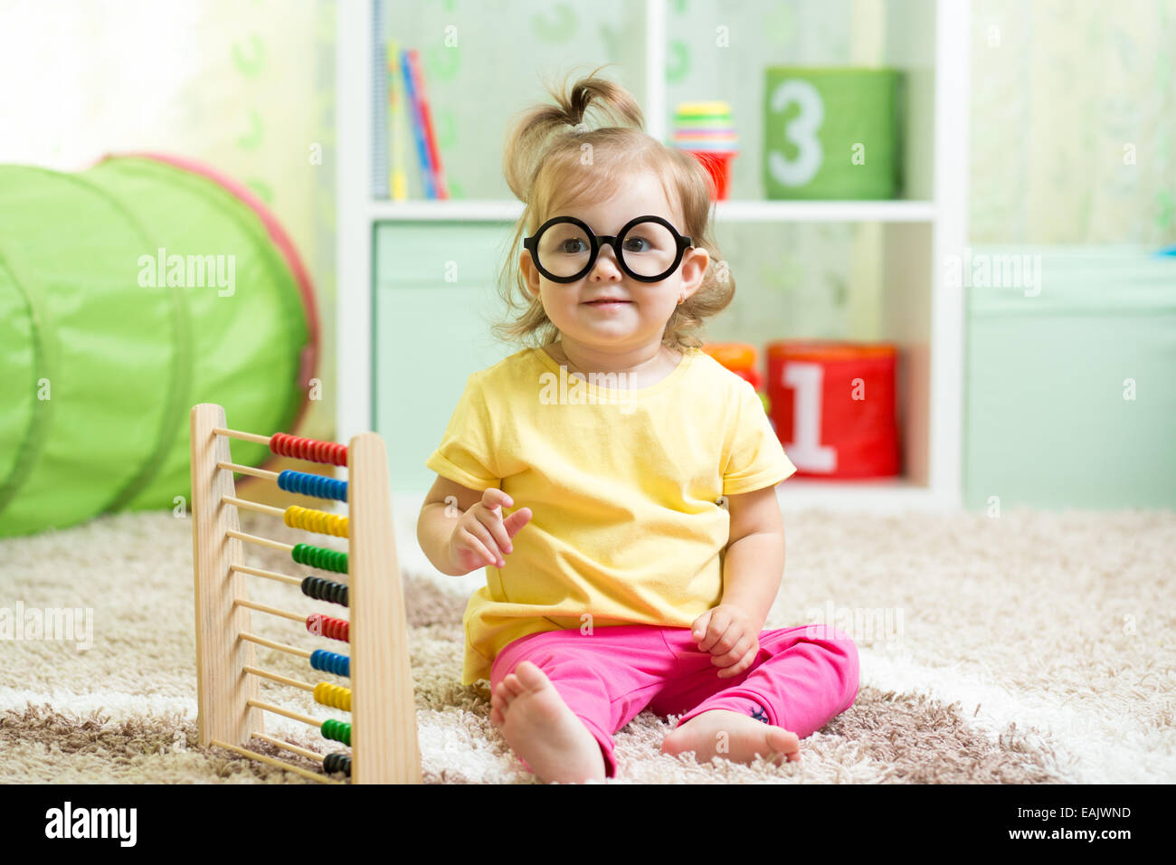 child with eyeglasses playing abacus - Stock Image