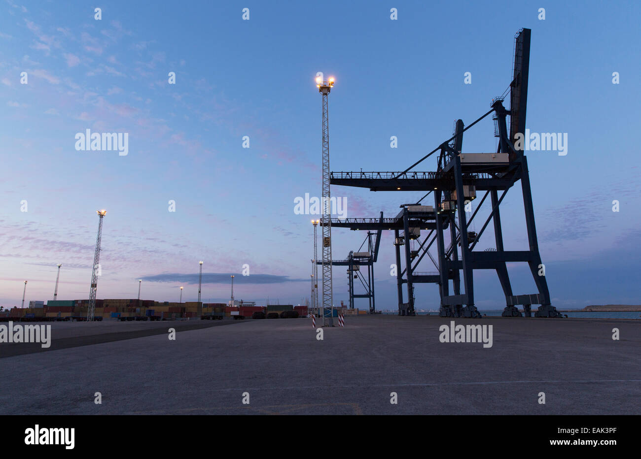 Cargo cranes at night - Stock Image