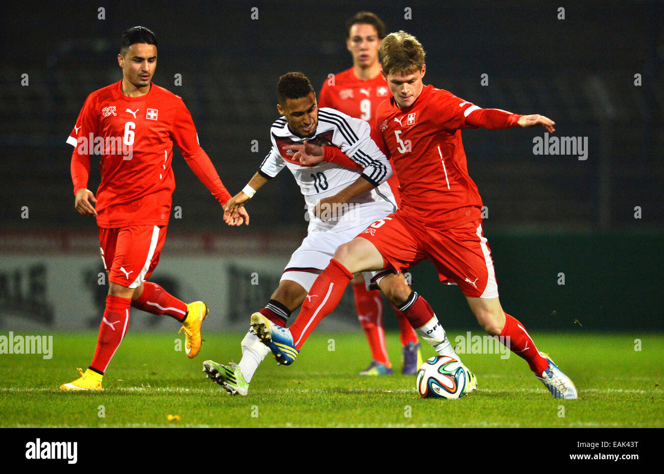 Germany's Hany Mukthar (C) and Switzerland's Marco Thaler vie for the ball during the U-20 international - Stock Image
