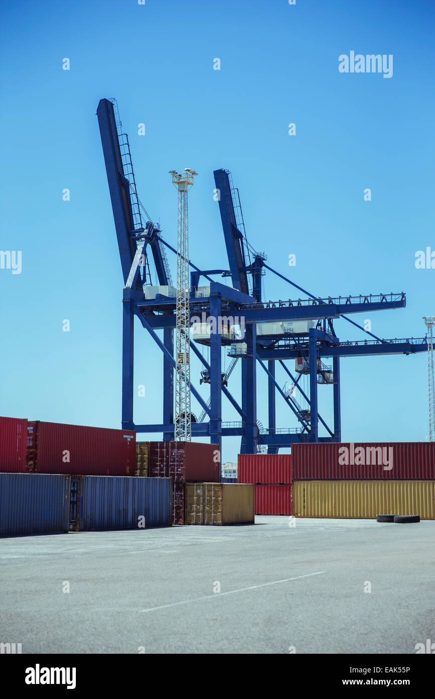 Cranes over cargo containers - Stock Image
