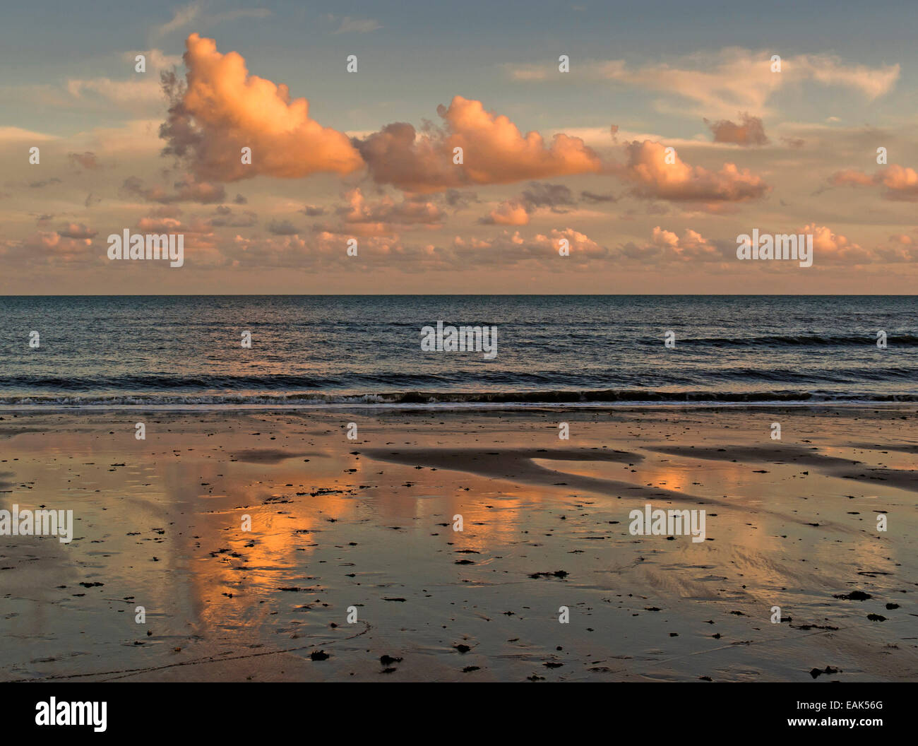 Clouds at Sunset over Poole bay reflected on West Beach, Bournemouth, Dorset, UK Stock Photo