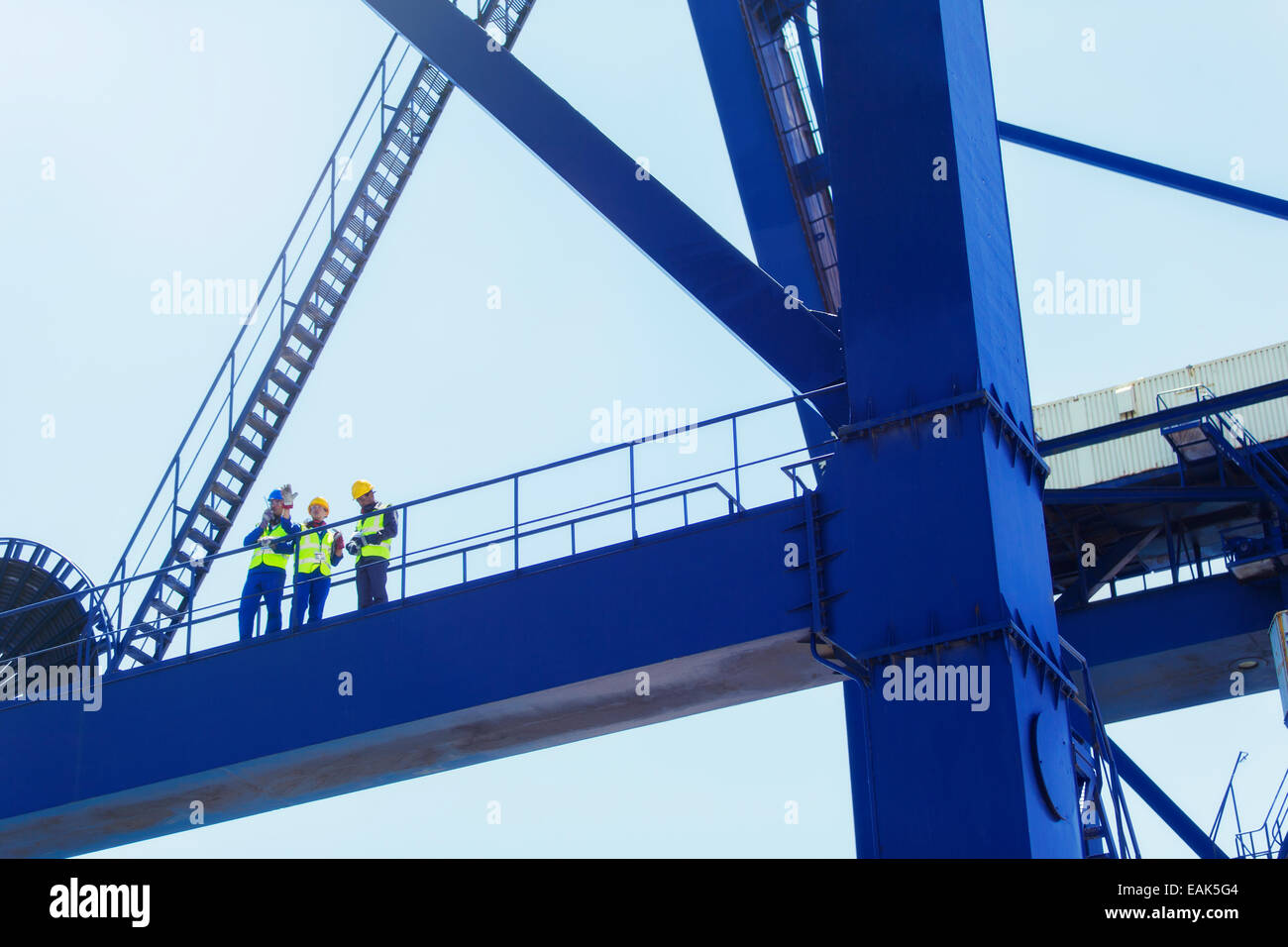 Low angle view of workers on cargo crane - Stock Image