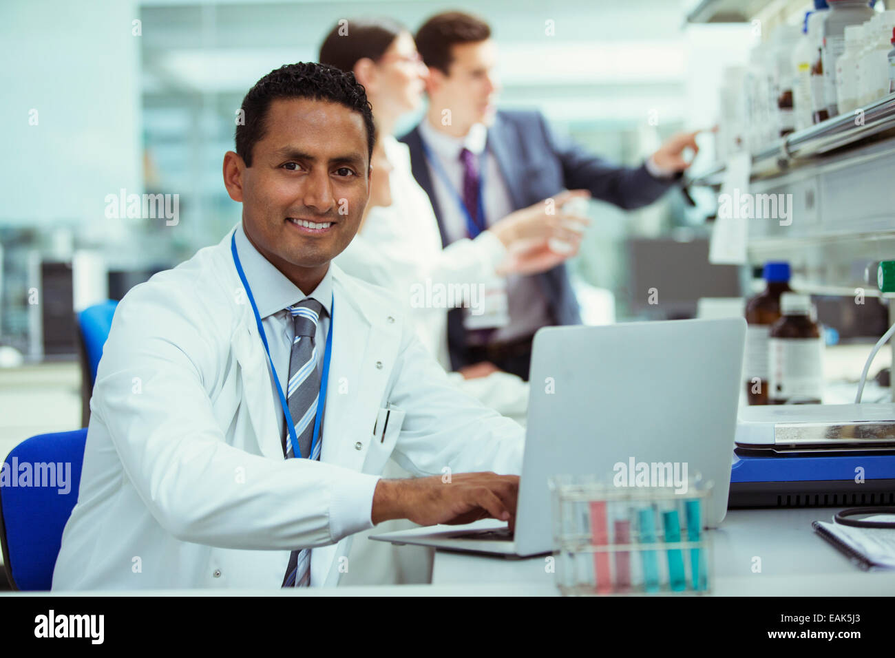 Scientist working on laptop in laboratory - Stock Image