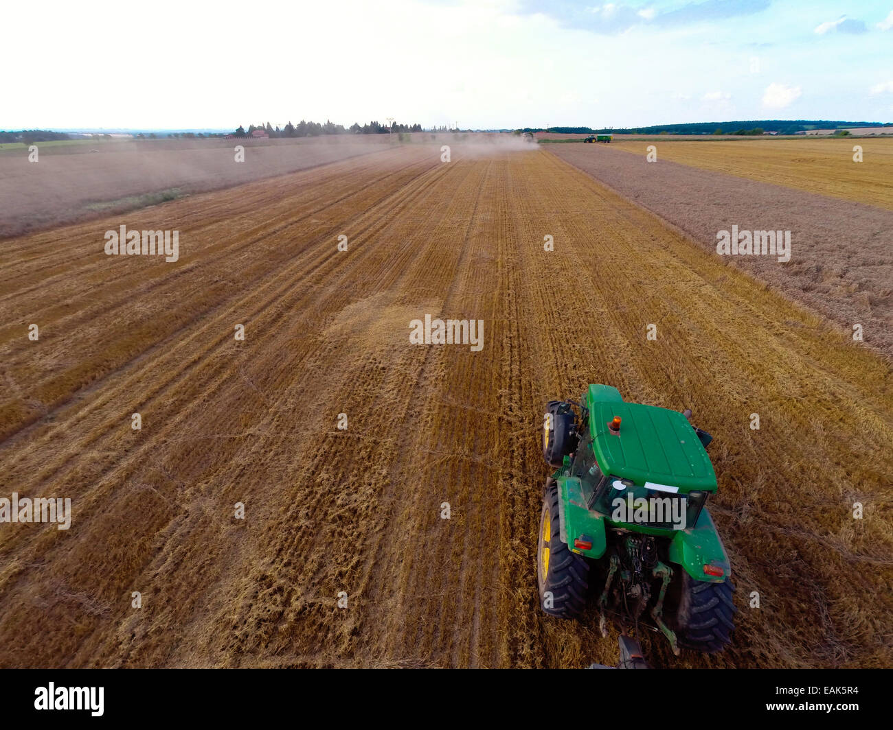 Bird-eye view of tractor on wheat field - Stock Image