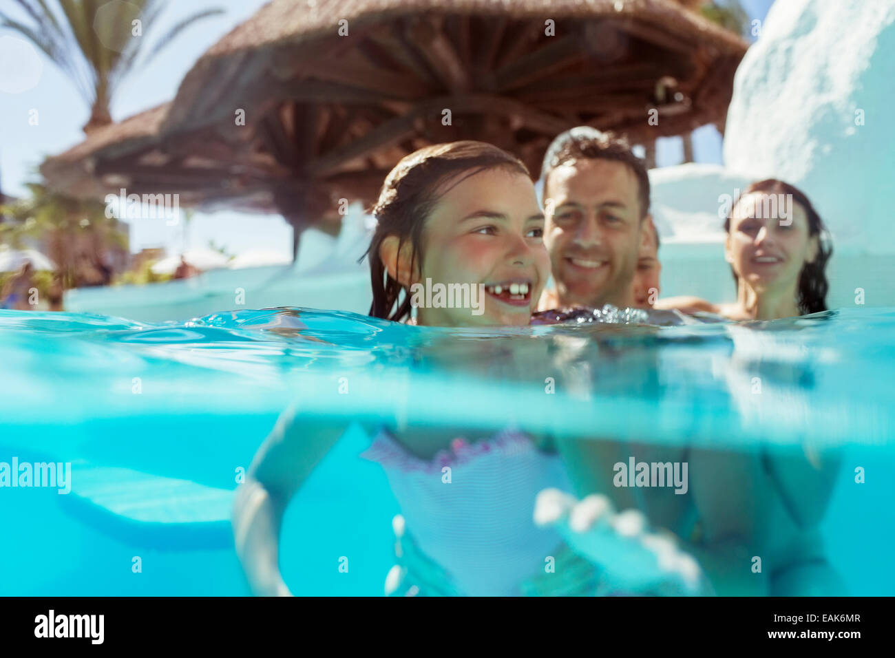 Family with two children in swimming pool on vacation - Stock Image