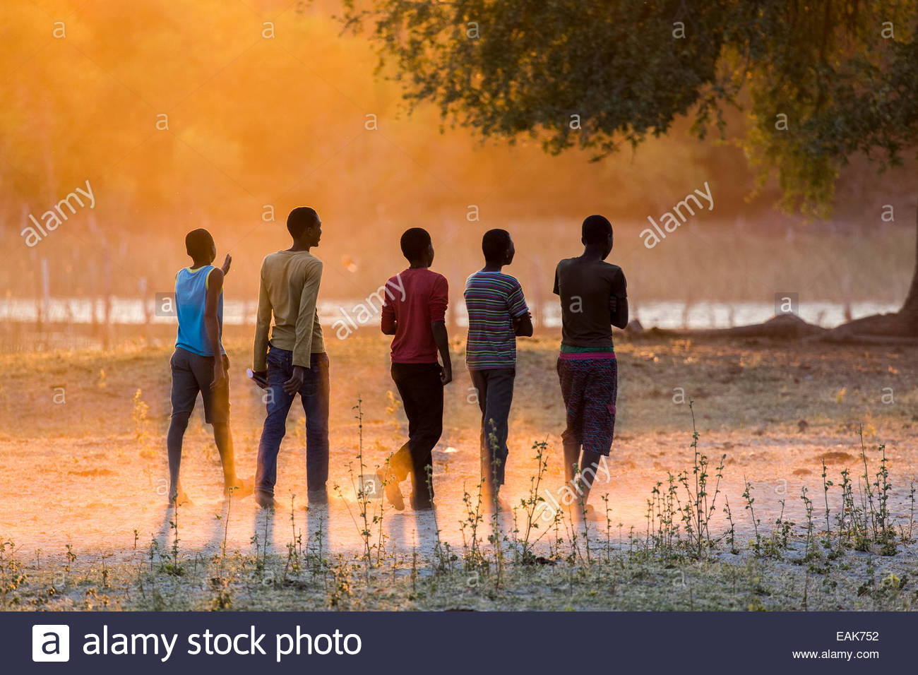 Youths taking an evening stroll, Okavango Delta, North-West District, Botswana - Stock Image