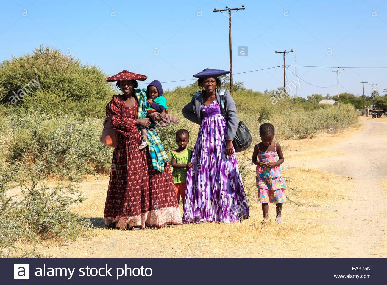 Herero women with children, Kalahari, Botswana - Stock Image