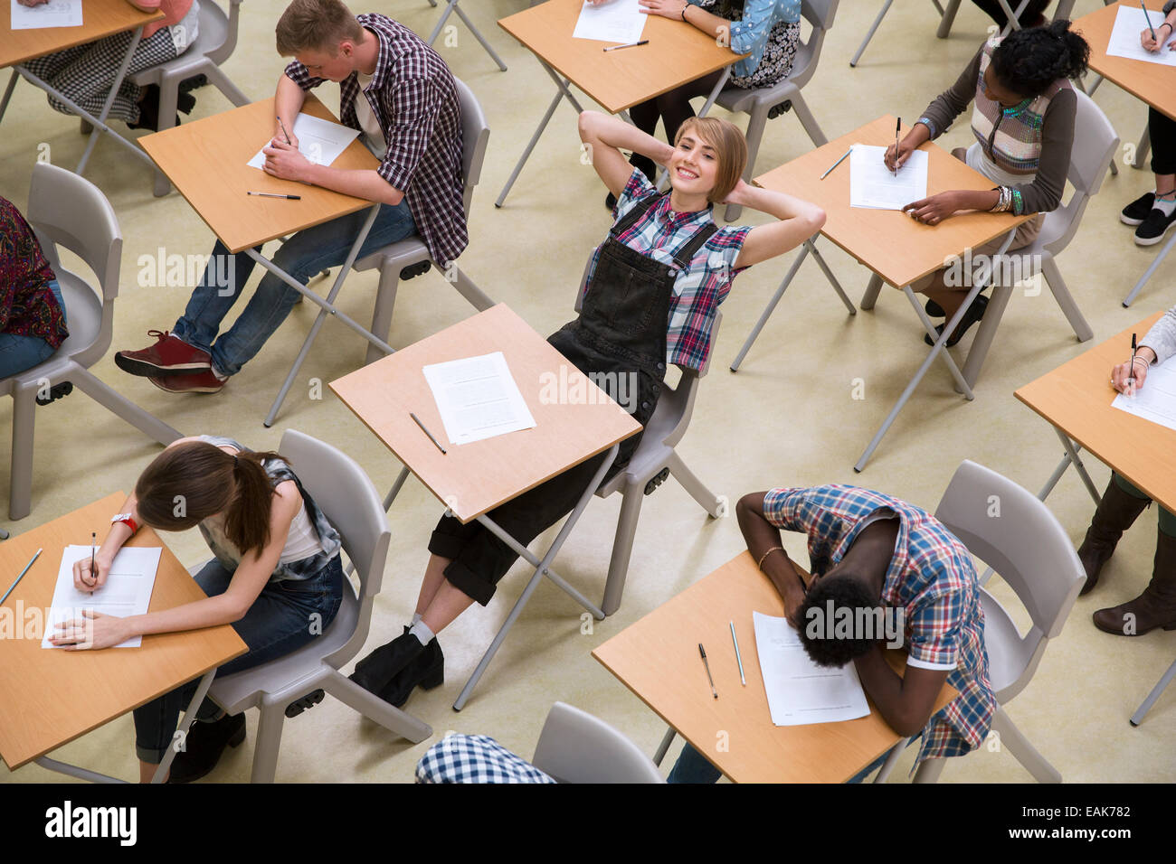 Students writing their GCSE exam in classroom Stock Photo