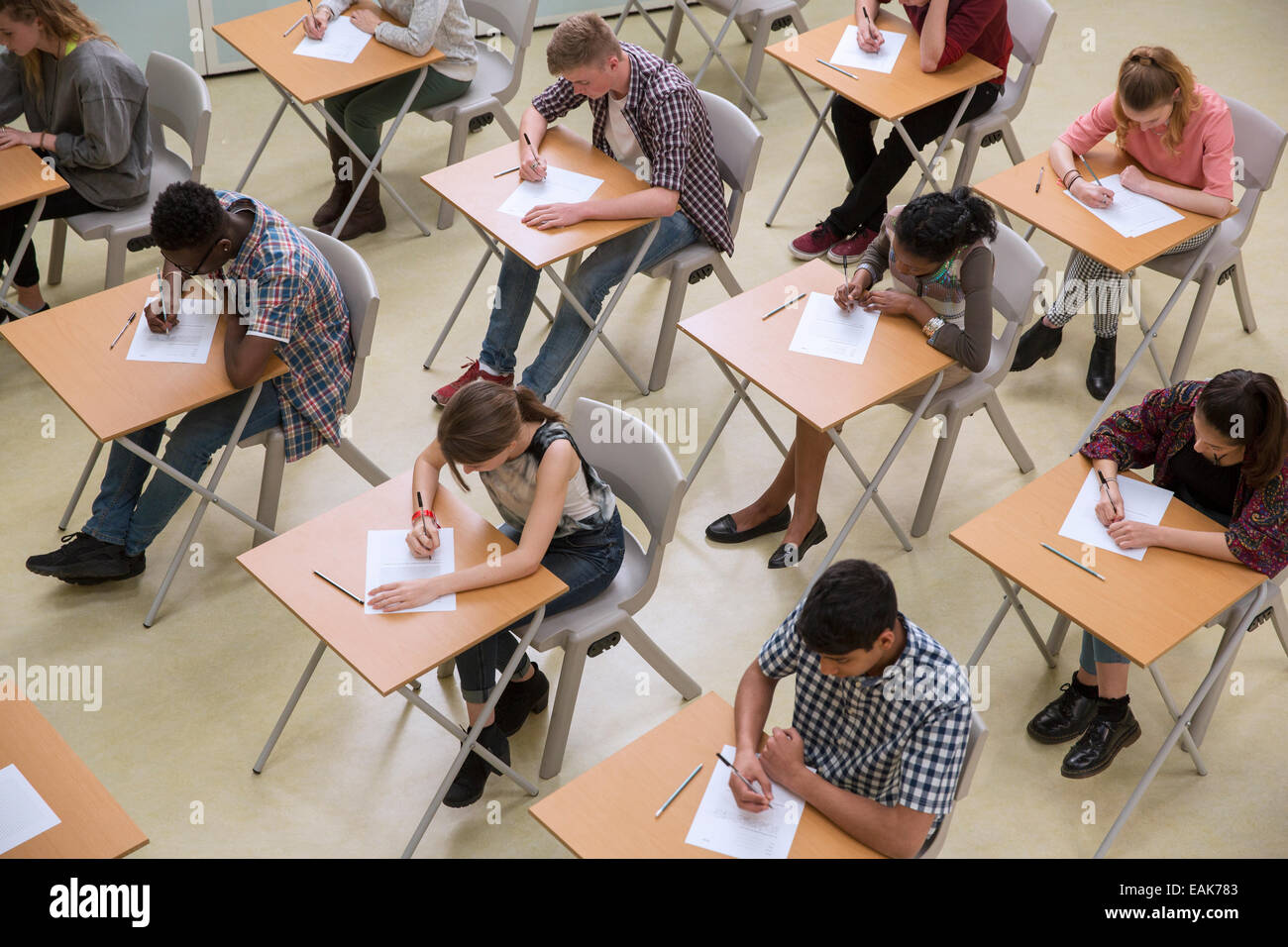 Elevated view of students writing their GCSE exam - Stock Image