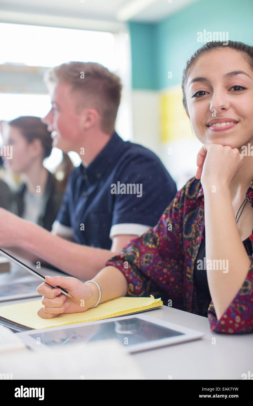 Students in classroom posing during lesson - Stock Image