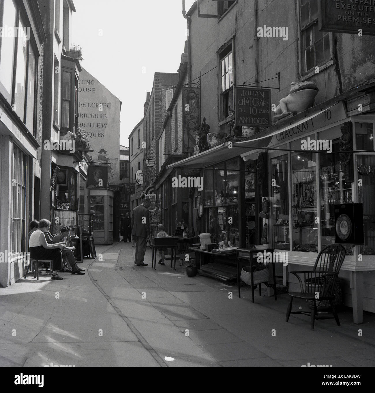 1950s, historical, row of small antique or bric-and-bric shops in The Lanes passageway in the old Old Town, Hastings, - Stock Image