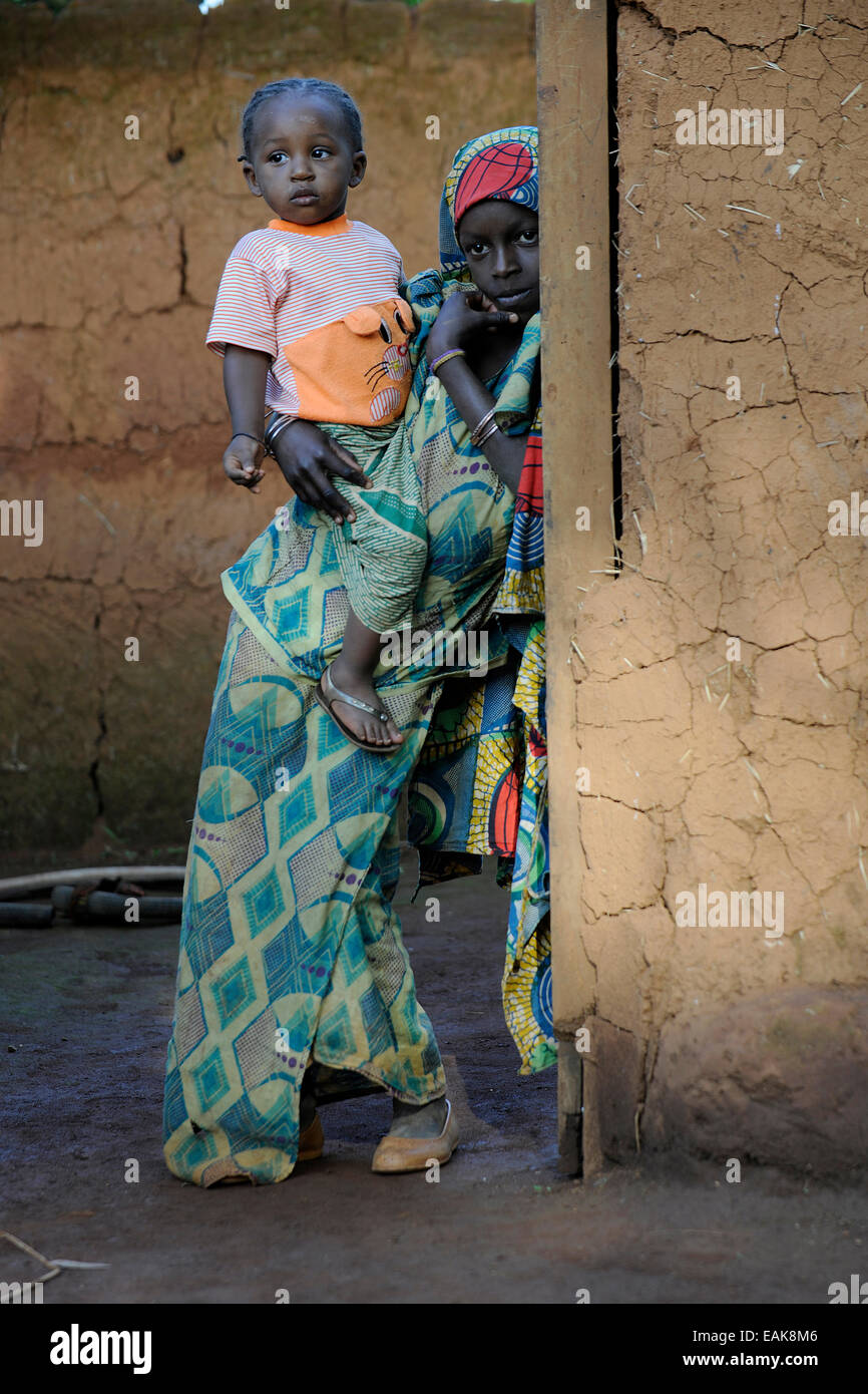 Young girl holding her younger sister in the village of Idool, Idool, Adamawa Region, Cameroon - Stock Image