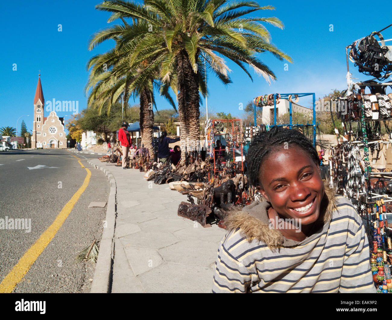 Saleswoman at the souvenir market, Evangelical Lutheran Church of Christ at the rear, Windhoek, Namibia - Stock Image