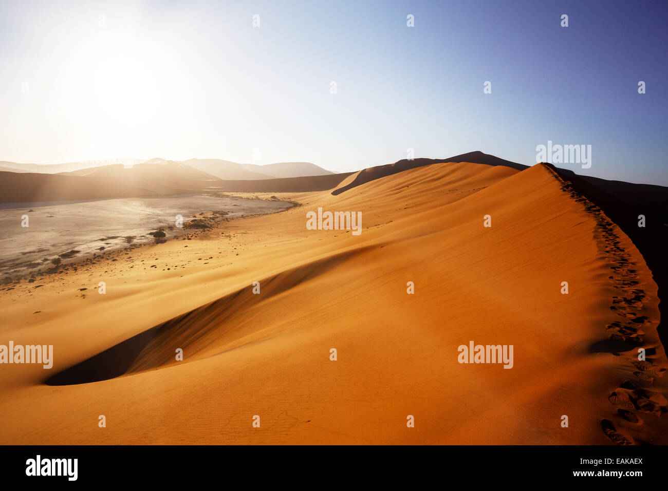 beautiful sunrise landscape of hidden Dead Vlei in Namib desert with blue sky, this is best place in Namibia - Stock Image