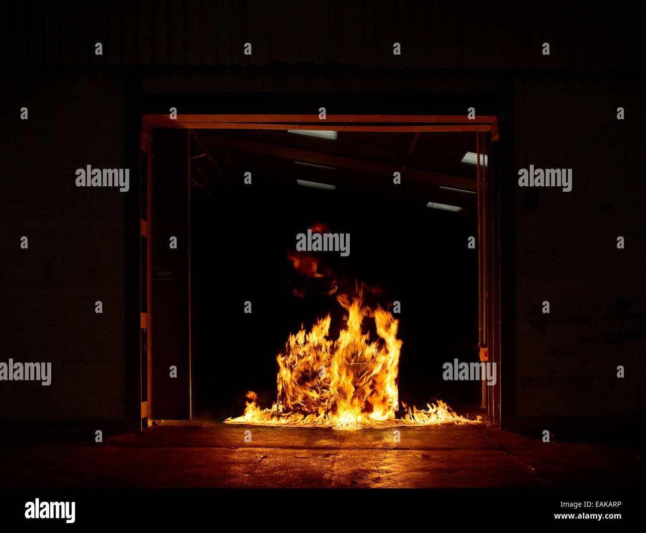 set of drawers on fire engulfed in flames - Stock Image
