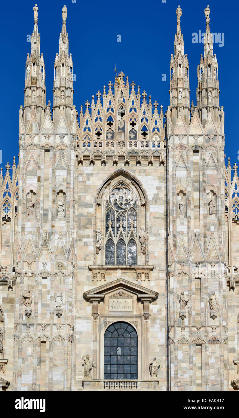 Spires, towers and windows of the west facade of Milan Cathedral or Duomo di Santa Maria Nascente, Milan, Lombardy, Stock Photo