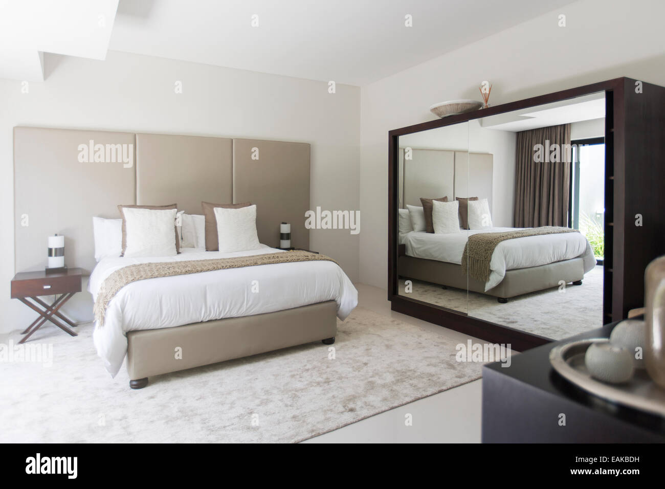 White and beige modern bedroom with double bed mirror Stock ...