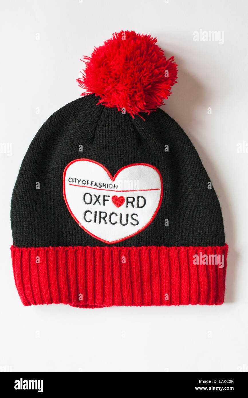 9c3a726e7c7 Oxford Circus city of fashion black red and white hat with pompom bobble hat  isolated on white background