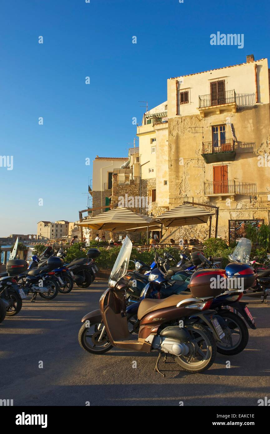 Motor scooters in a parking lot, Cefalù, Province of Palermo, Sicily, Italy - Stock Image