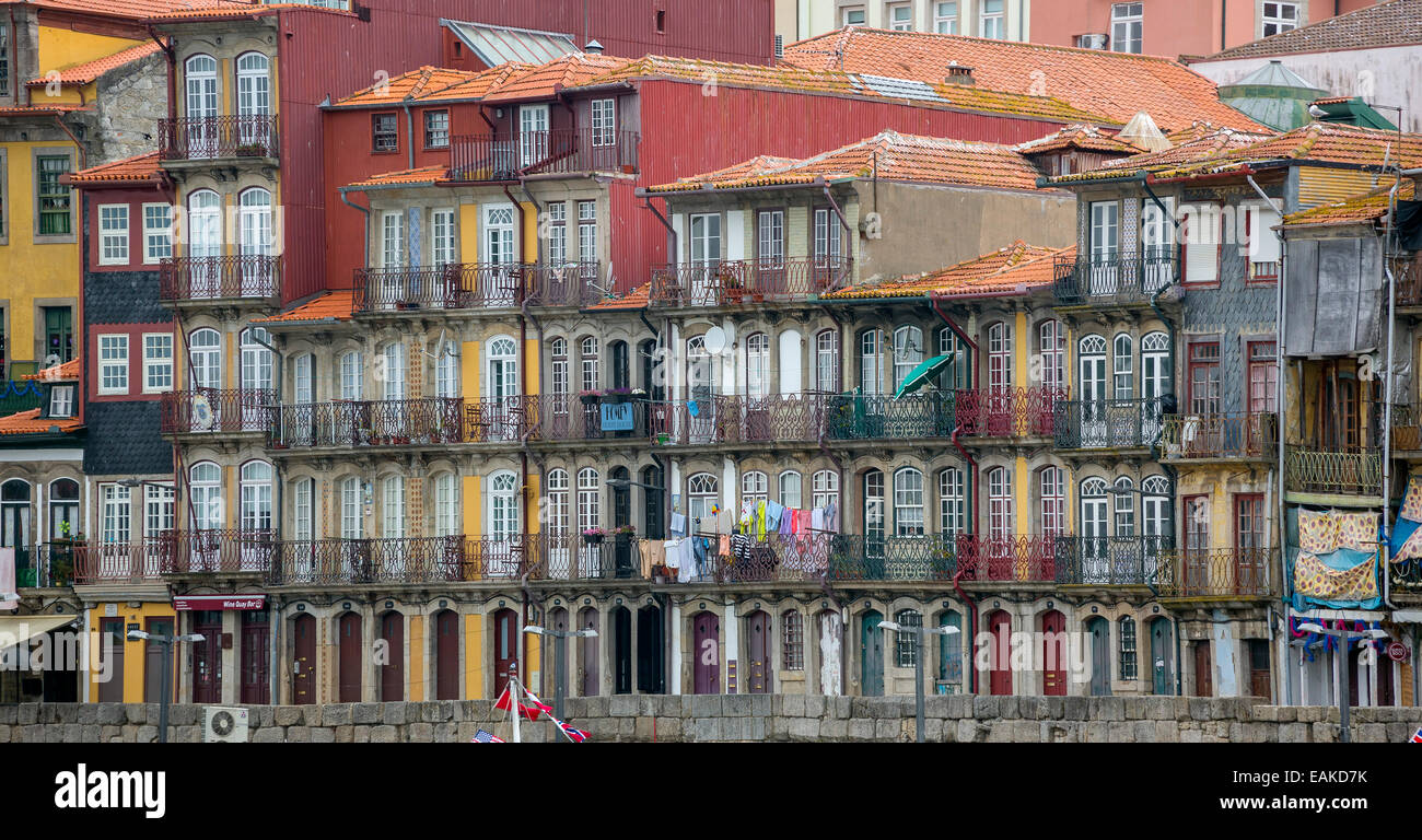 Colourful houses on the banks of the Douro River, Ribeira, Porto, District of Porto, Portugal - Stock Image