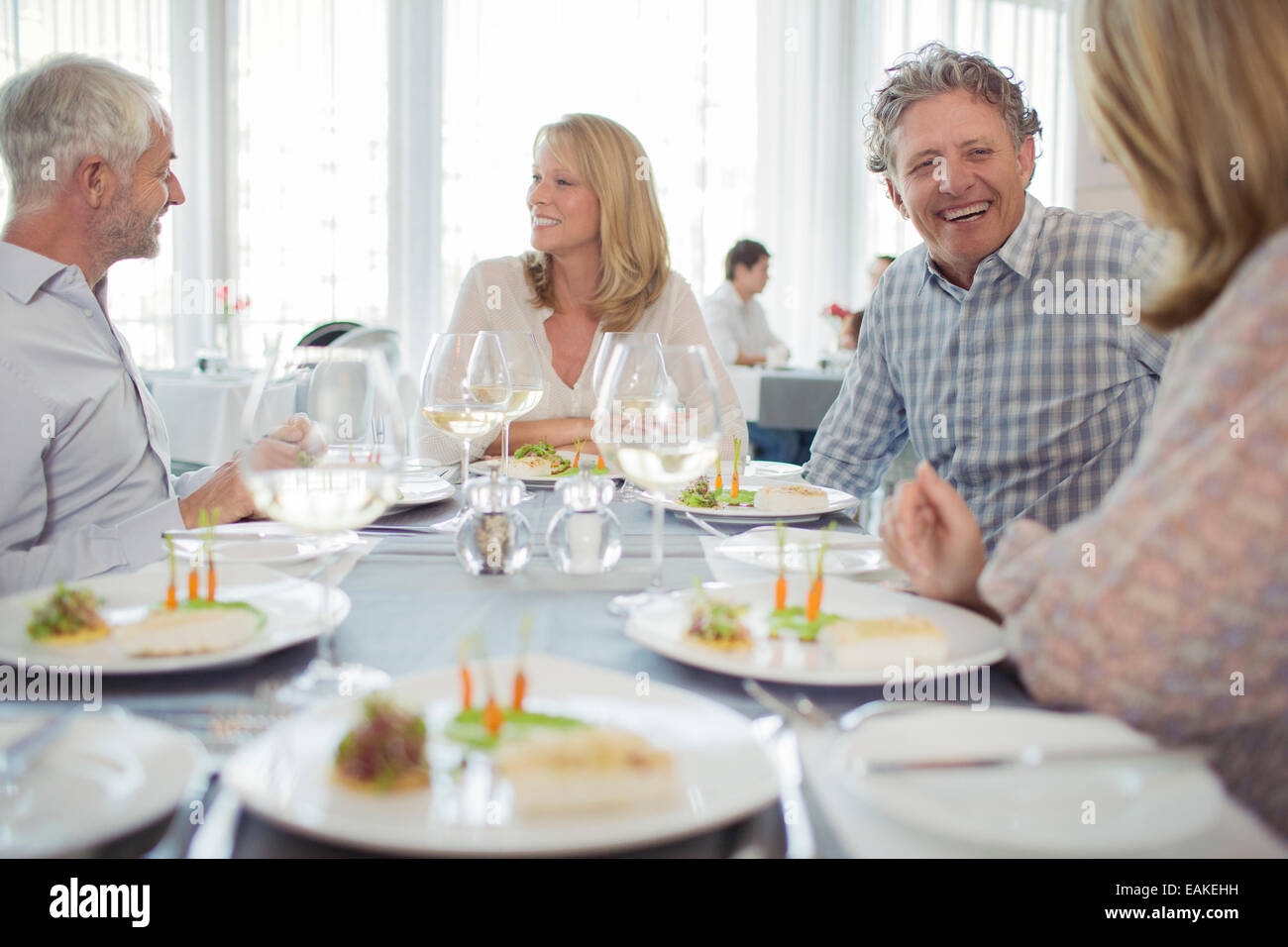 People Enjoying Fancy Meal In Restaurant Stock Photo Alamy