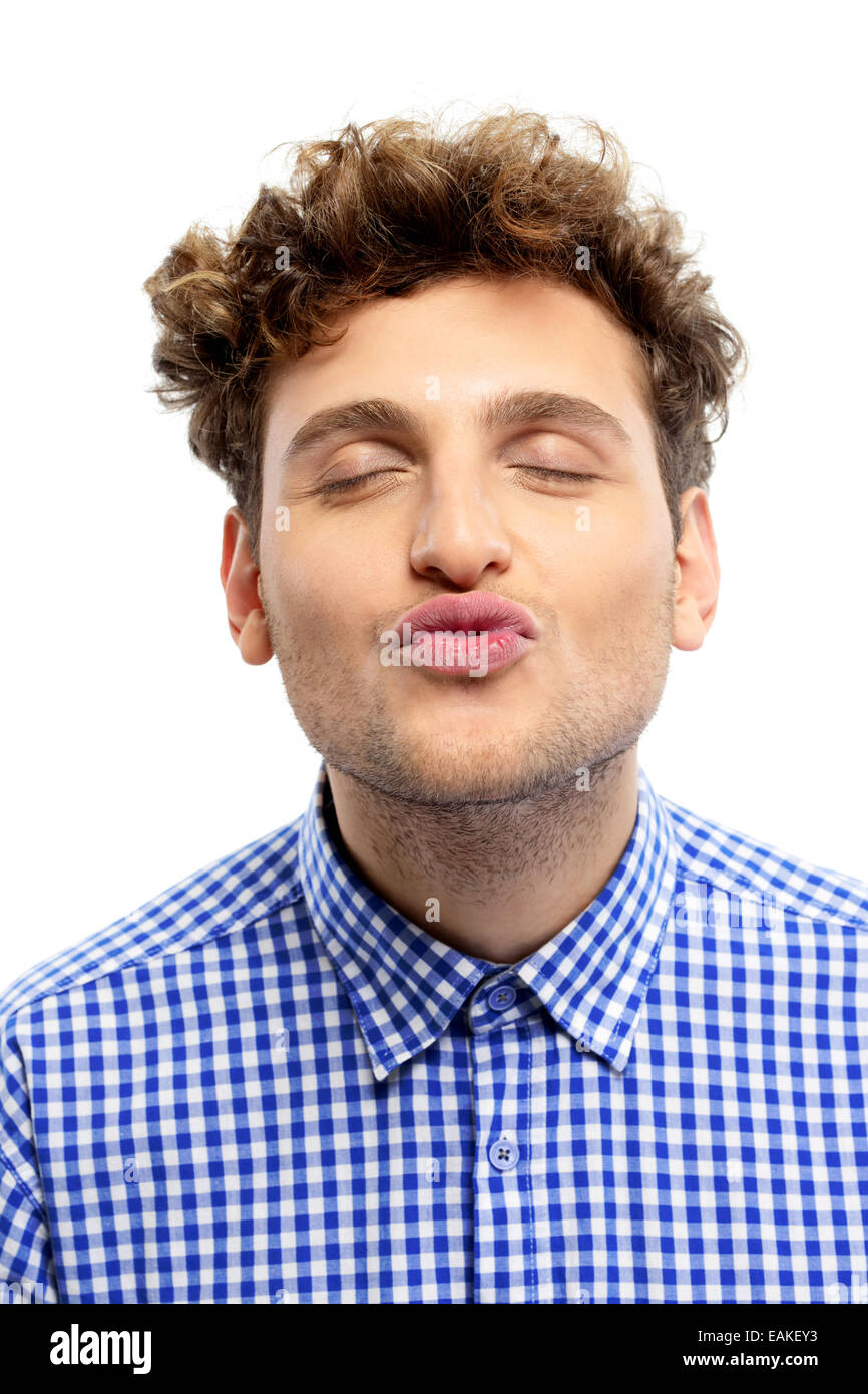 Portrait of a handsome young man kissing camera - Stock Image