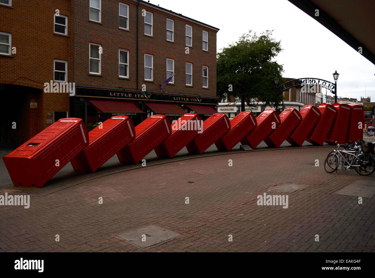 Tipsy telephone boxes.By David Mach - Stock Image