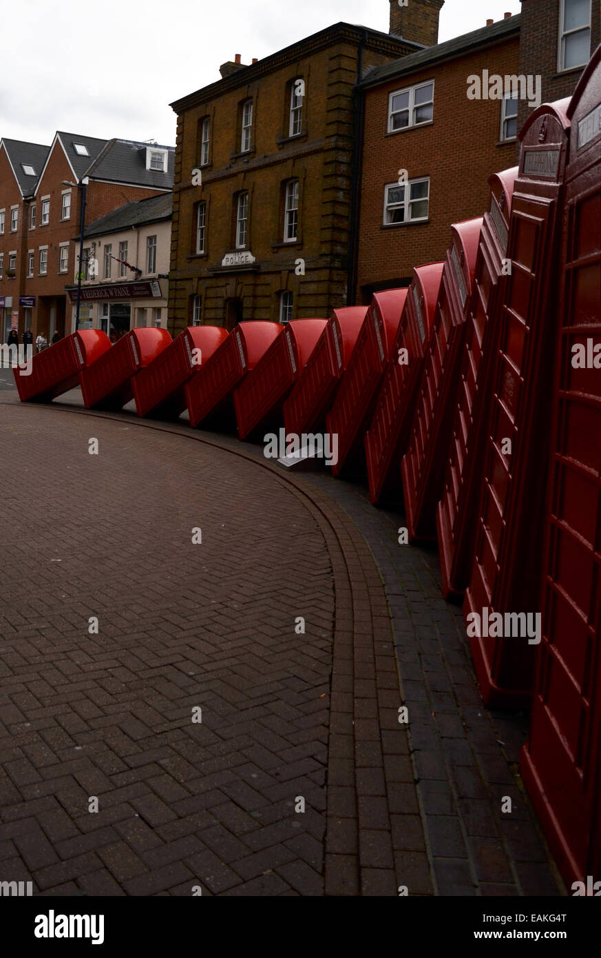 Tipsy telephone boxes. By David Mach - Stock Image