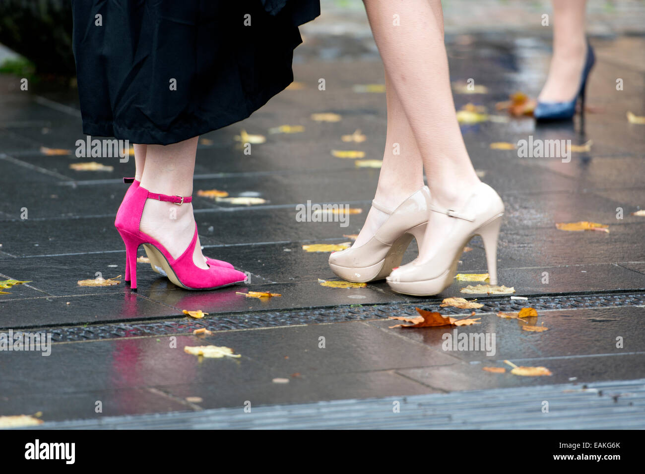 Coventry University graduation day - young women wearing stiletto heels - Stock Image