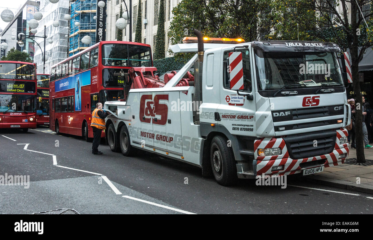 broken down bus on London's oxford street - Stock Image