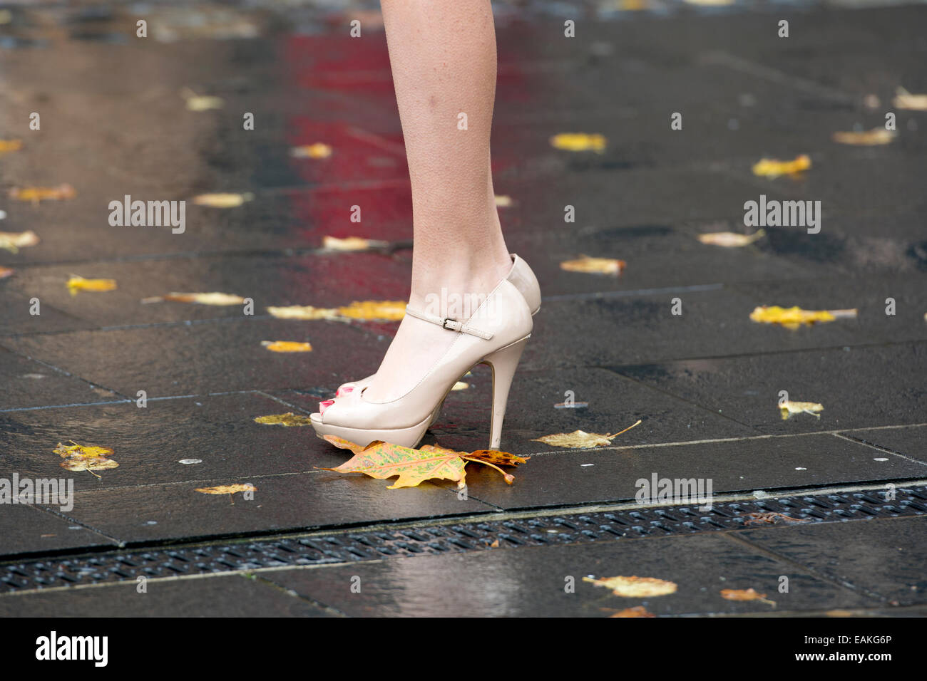Coventry University graduation day - young woman wearing stiletto heels - Stock Image