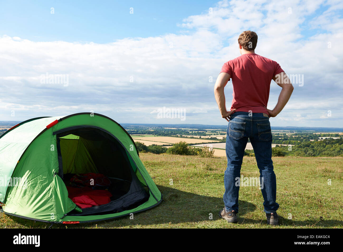 Rear View Of Man Camping And Admiring View - Stock Image