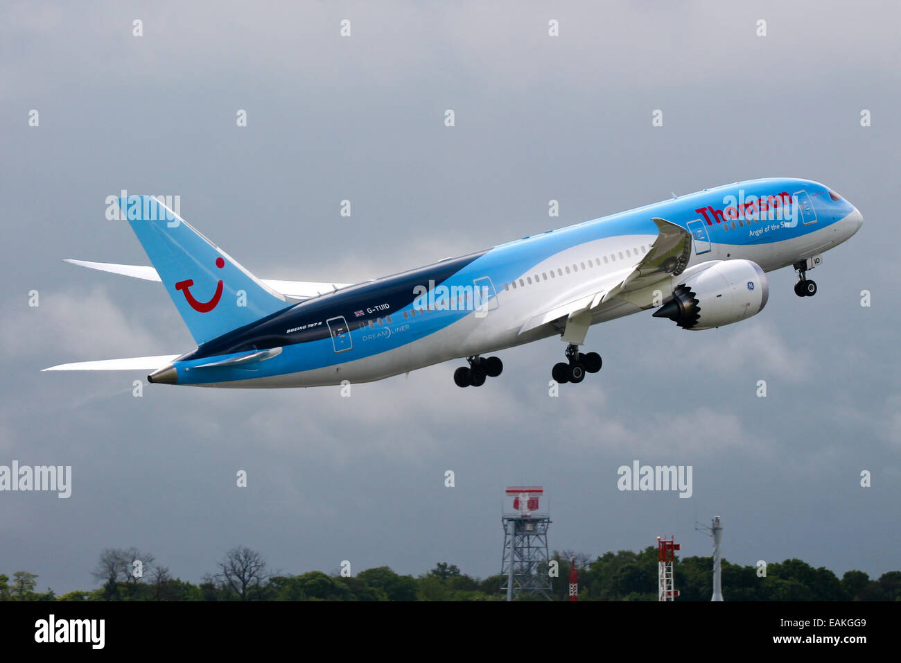 Thomson Airways Boeing 787-8 rotates away from runway 23R at Manchester airport. - Stock Image