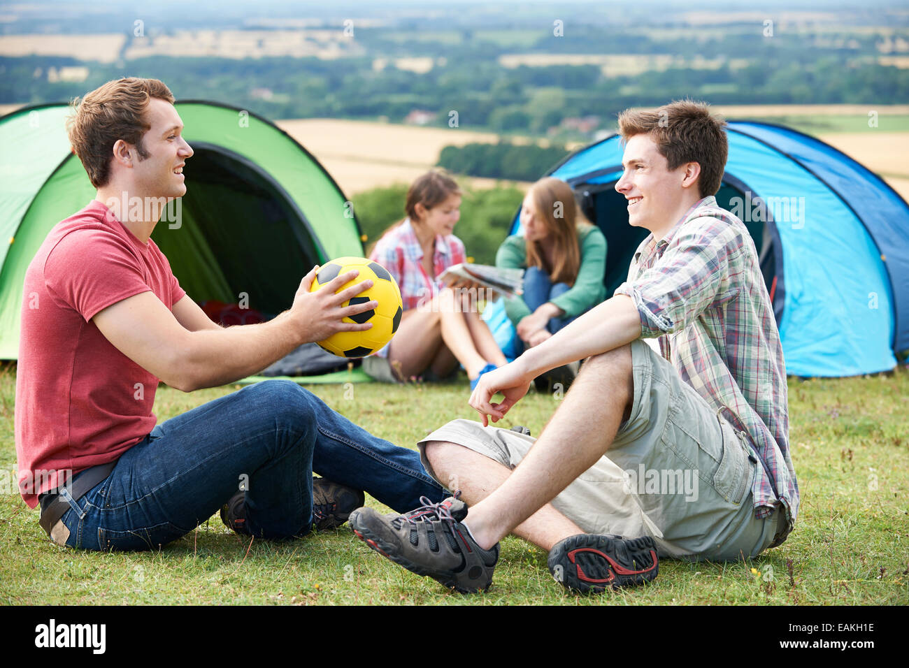 Group Of Young Friends Camping In the Countryside - Stock Image