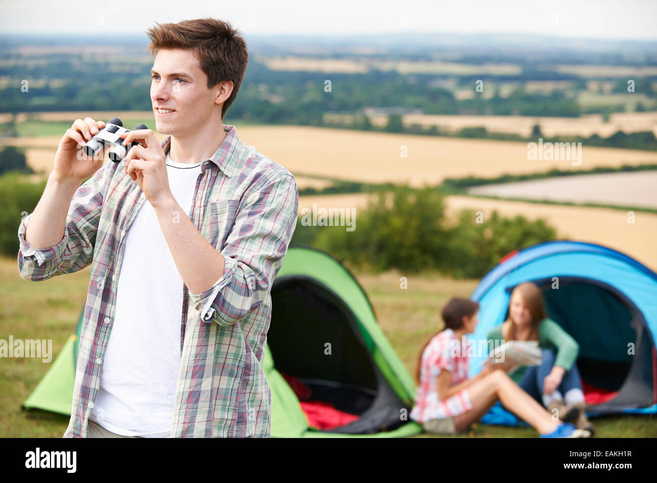 Group Of Young Friends Camping In Countryside - Stock Image