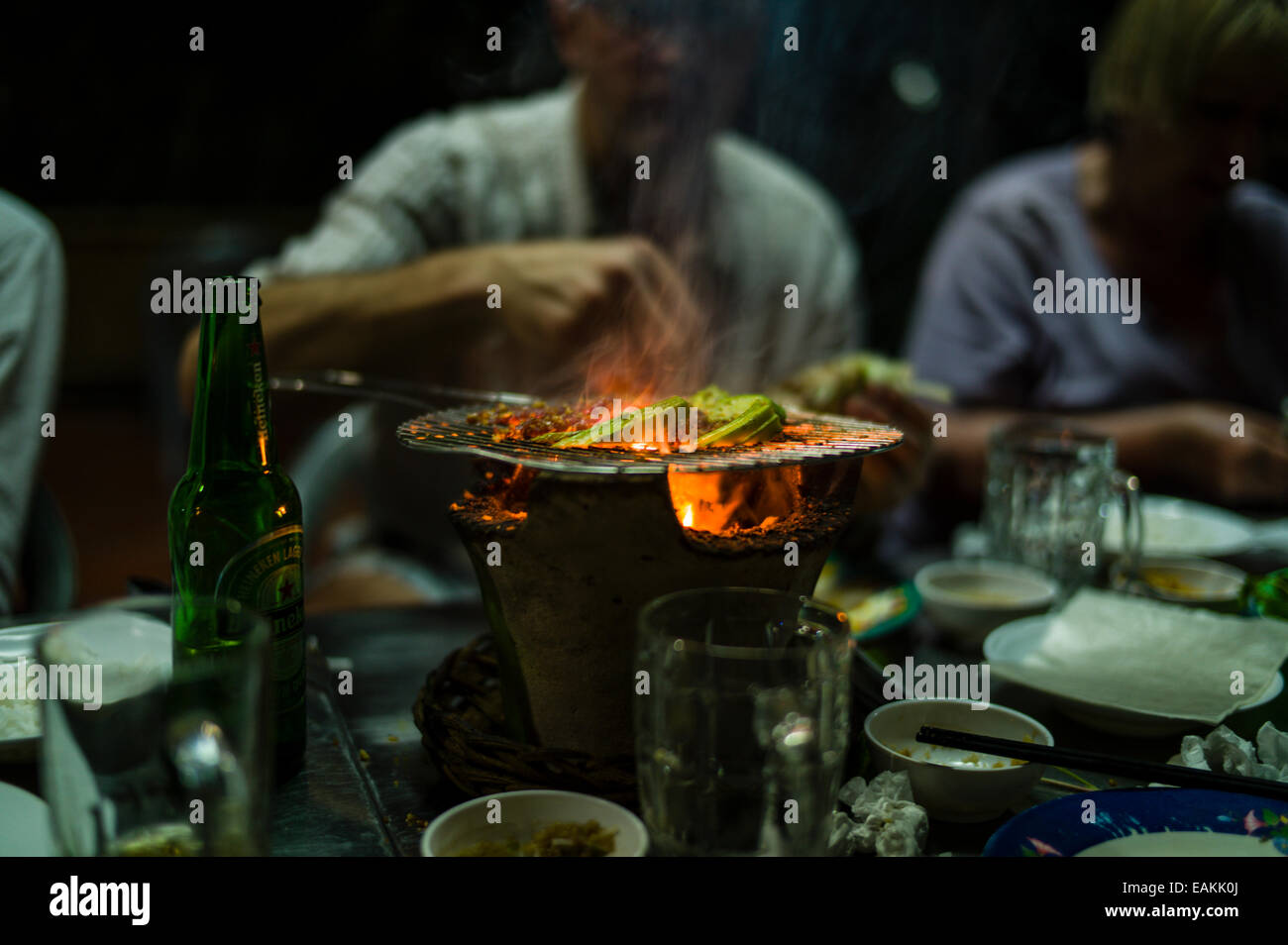 Beef And Okra Cooking On A Tabletop Charcoal Grill In An Outdoor Restaurant  In Tra Vinh, Vietnam.