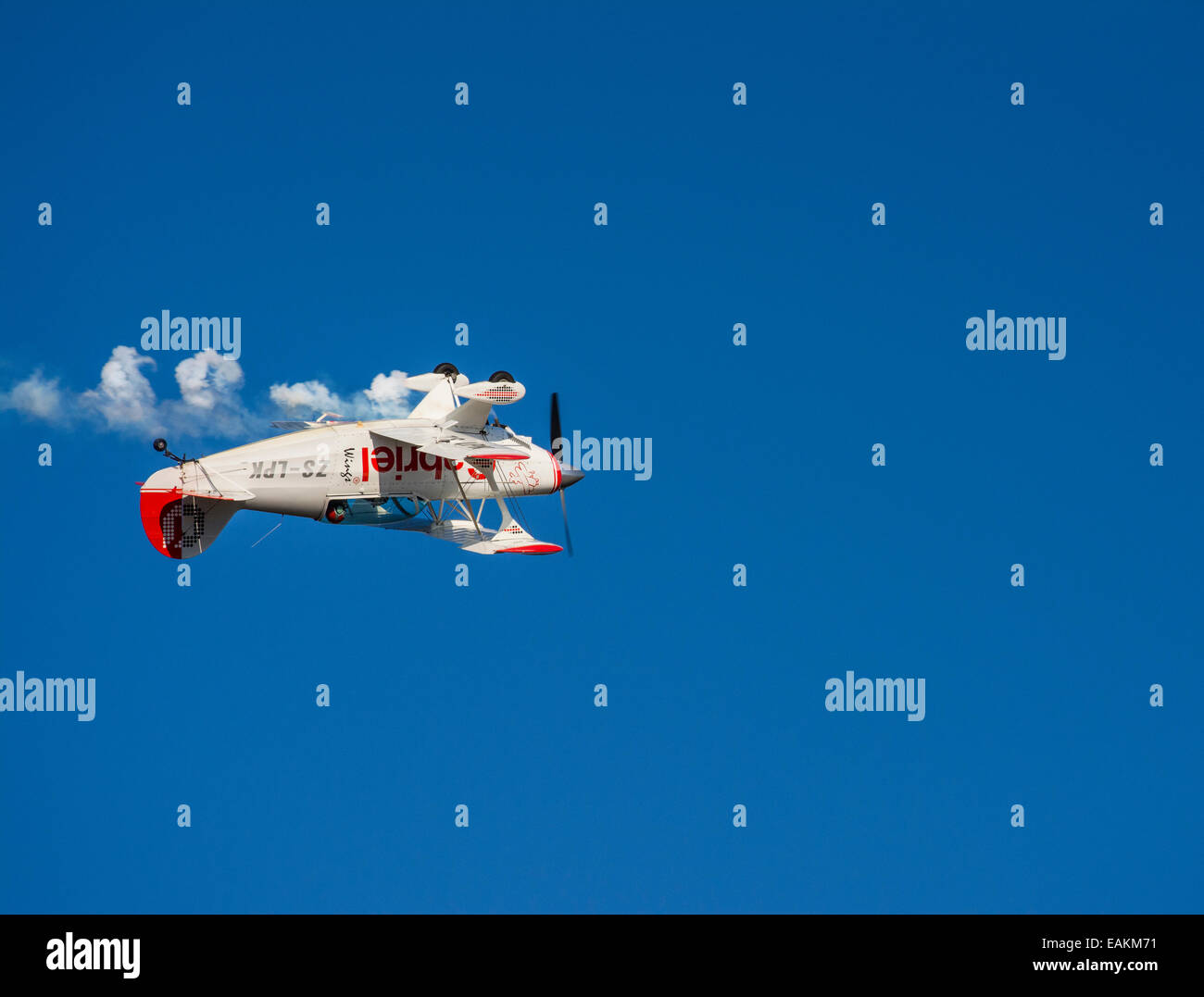 An aerobatics aircraft flying upside down at the Lowveld Air Show - Stock Image